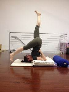 Eka Pada Sarvangasana lowering my right leg.